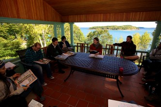 Classrooms don't need four walls. Heath Cabot and her students on porch of the Straus Room, with Bar Island and Frenchman Bay in the background.