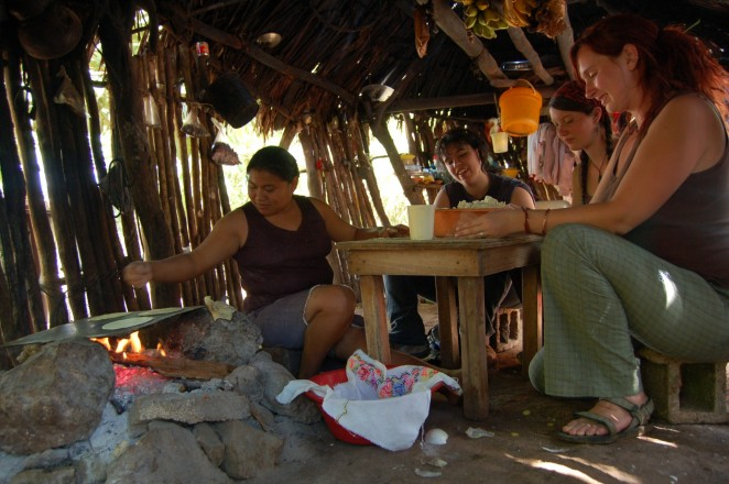 Students making tortillas by hand.
