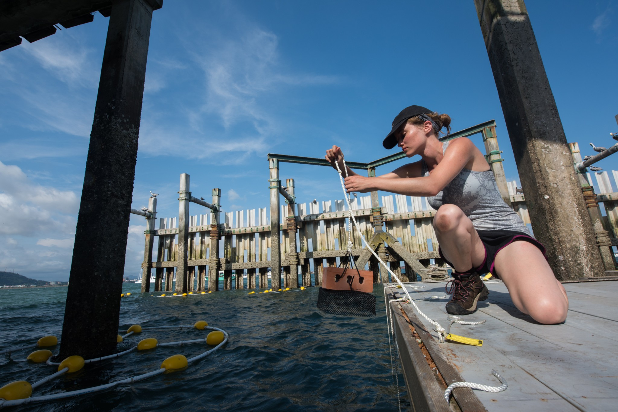 Alyssa Murad '19 puts a settlement plate into the Bay of Panama off the Smithsonian Tropical Research Institute's (STRI) Naos Island dock. Thousands of such plates, which become colonies for marine creatures, are being deployed by STRI as part of The BioVision Project. Murad is working at STRI as part of COA's vigorous internship program.