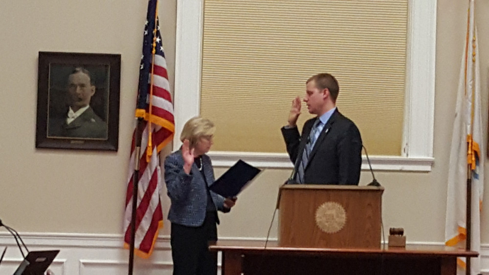 Mike Zwirko '01 being sworn in as the President of the Board of Aldermen in Melrose, MA.