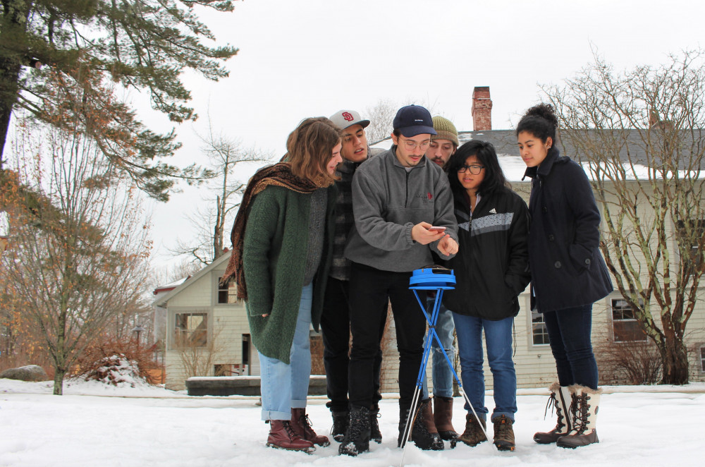 College of the Atlantic students use a Solar Pathfinder to determine photovoltaic power potential...