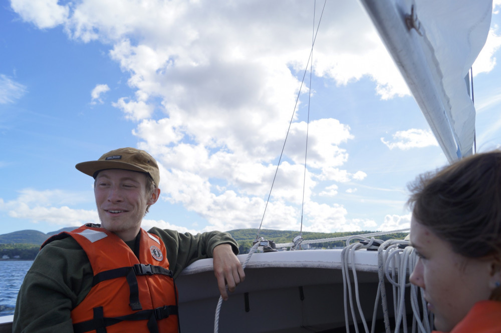 A College of the Atlantic student enjoys the end-of-the-week sailing expedition as provided by COA's Outing Club.