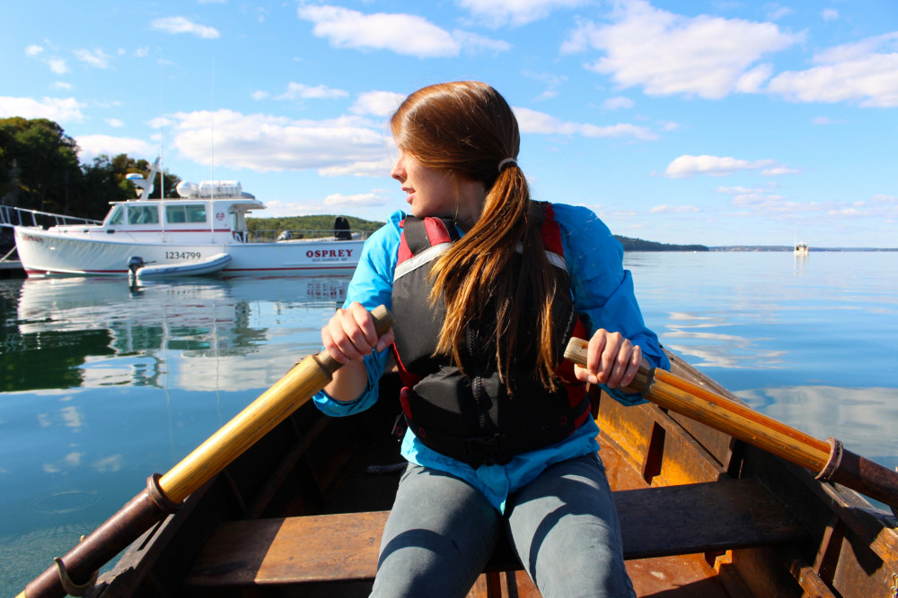 "Sailing program participant Taylor Mason '17 hones her skills in rowing on Frenchman Bay, just off the <a href=""/boats/"" target=""_blank"" rel=""noopener noreferrer"">COA pier</a>."