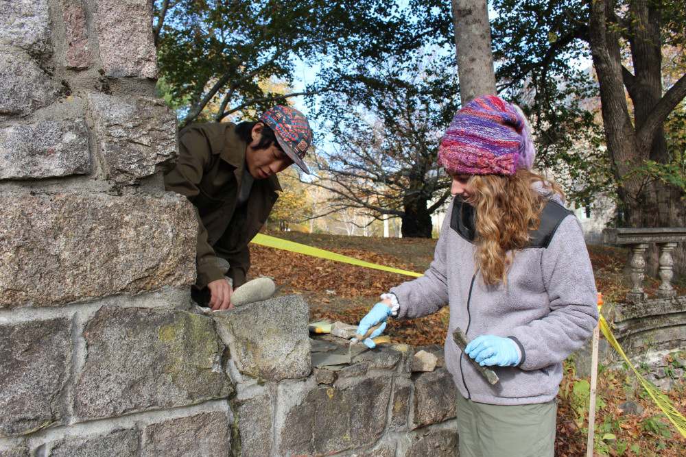 Students at College of the Atlantic, led by senior Yaniv Korman '18 and with the help of Sullivan, Maine's <em>Creative Stone</em>, work to restore a century-old arch at the entrance to the college's Sunken Garden.