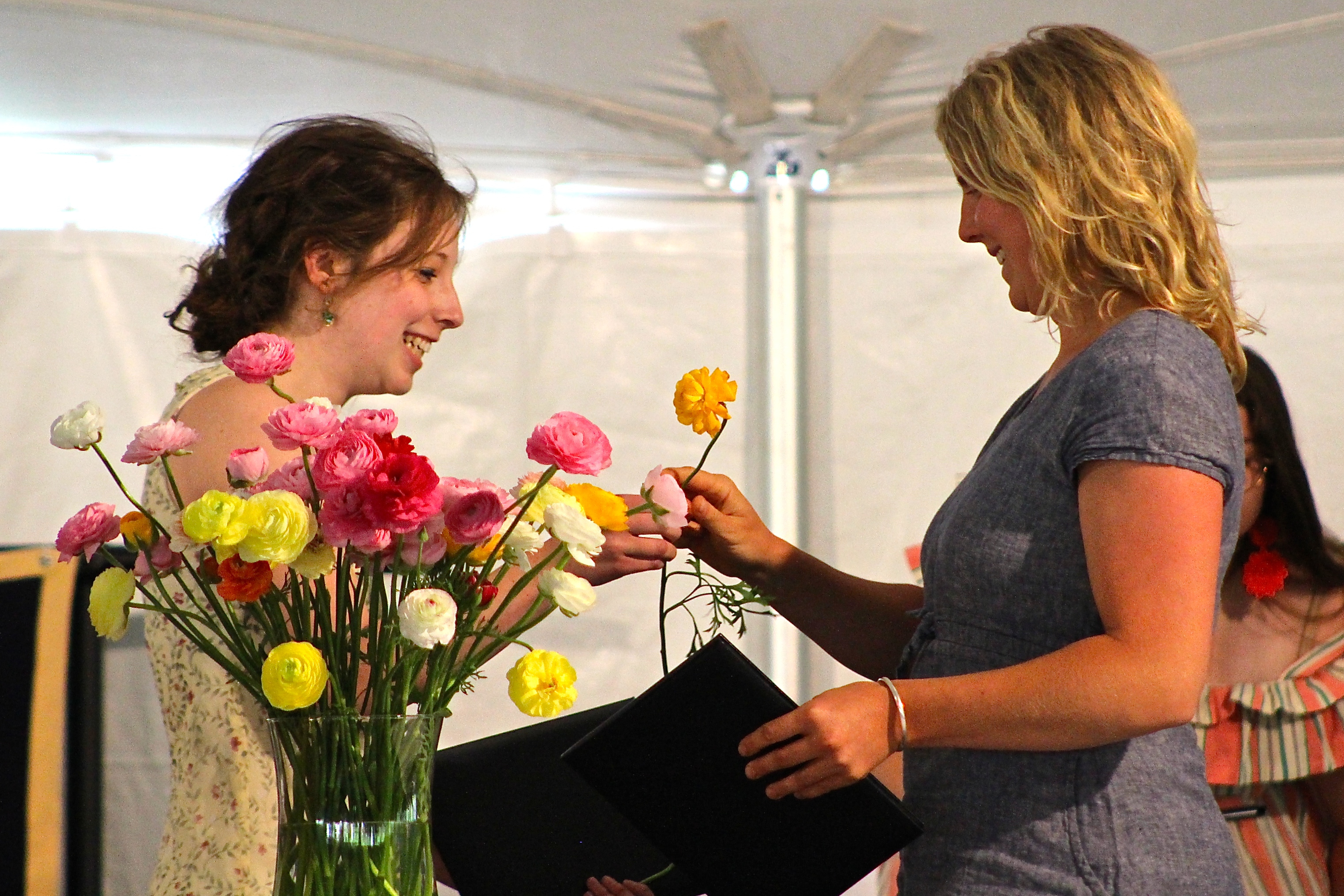 Following a long-standing tradition at College of the Atlantic, graduating students present each other with flowers to symbolize their shared experience and affection for one another. Carolyn Snell '06 provided the Ranunculus from her family farm in Buxton.