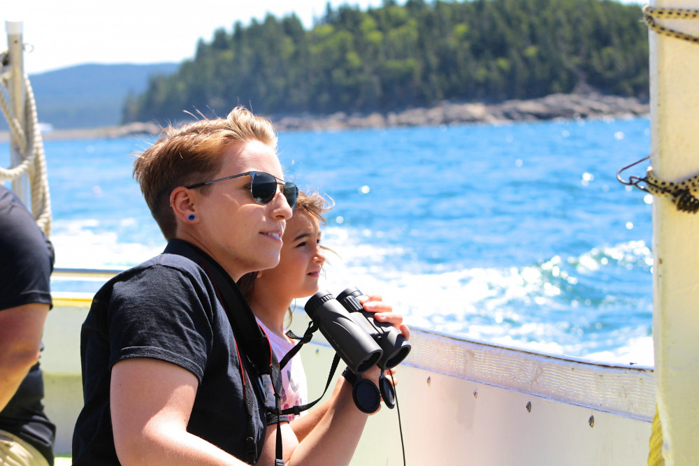 College of the Atlantic graduate student Kate Pielmeier MPhil '19 counts and tracks harbor porpoises on the Schoodic Ferry, which runs between the COA pier in Bar Harbor and the town of Winter Harbor, across Frenchman Bay.