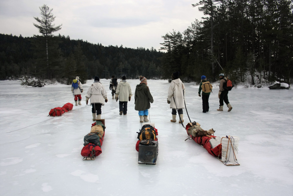 Trekking across frozen lakes in the middle of the Maine Wilderness is all part of a day's work fo...