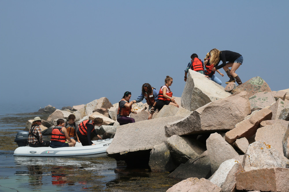 Islands Through Time students arriving at Mount Desert Rock, 25 miles out to sea and home to Col...