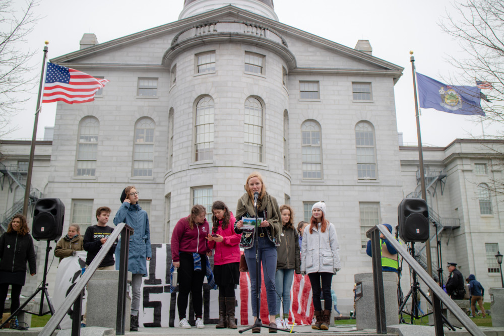 Maine Youth Day of Action Rally co-organizer Ania Wright '20 addresses the crowd from the ste...