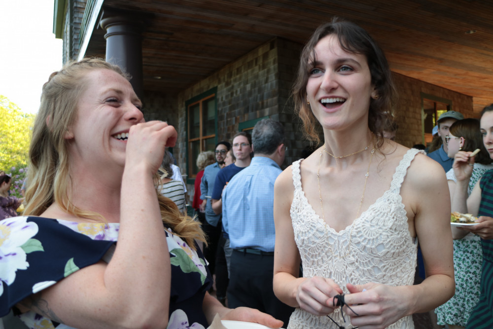 COA graduates Amy Erving, left, and Devyn Adams share a happy moment at the reception following the commencement ceremony.