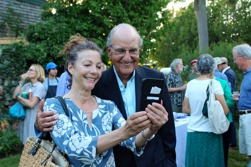 A guest at the 2018 COA Champlain Institute takes a selfie with Senator George Mitchell, one of t...
