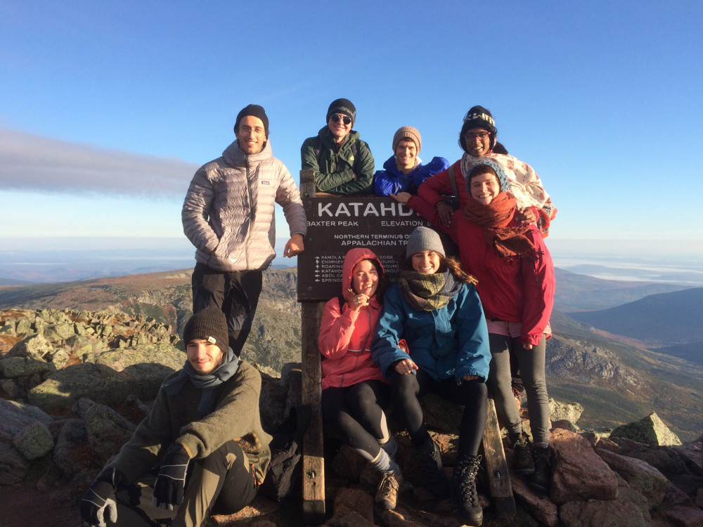 A group of College of the Atlantic students, led by Andrea Fontana '19 (top row, left), pose at the peak of Mount Katahdin.