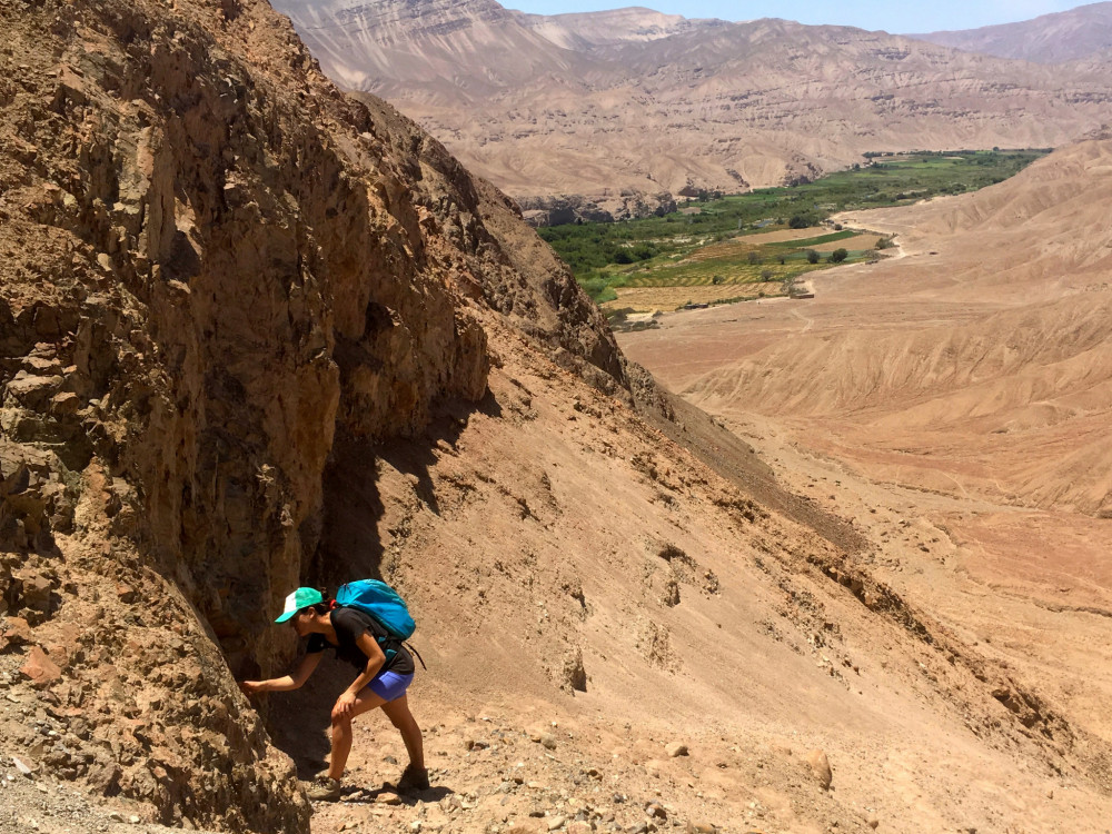 "Alba Mar Rodríguez Padilla '18 studies an outcrop exposure of the Samas-Calientes fault in Southern Peru. Rodríguez Padilla was recognized by the American Geophysical Union for her research in the <span style=""font-weight: 400;"">tectonophysics subfield of the <a href=""/academics/areas-of-study/math-physical-sciences/"">geosciences</a>.</span>"