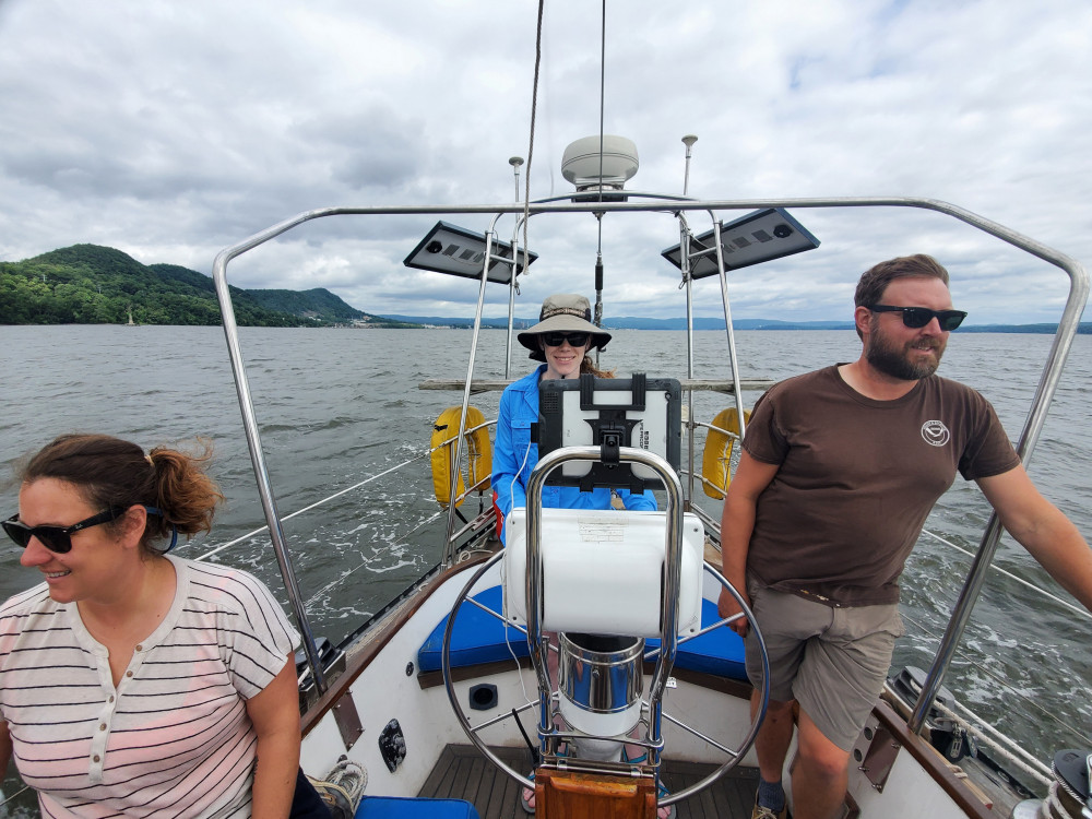 Crew members, from left, Tanya Lubansky, Lindsey Jones '18, and Chris Tremblay '03 pilot Rive...