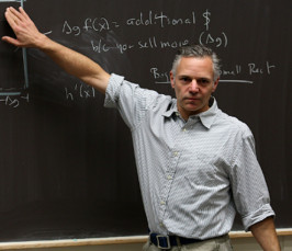 Faculty member Dave Feldman at the chalkboard.