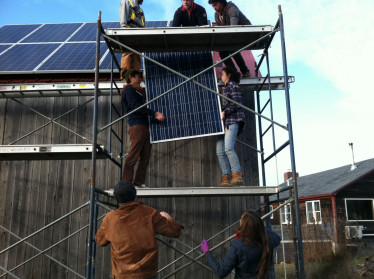 "College of the Atlantic students help install solar panels at <a href=""/farms/beech-hill-farm/"">Beech Hill Farm</a>. Through coursework, independent studies, workstudy jobs, and the Community Energy Center, students are involved in many local energy projects."