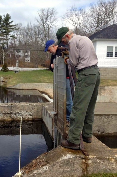 Chris Petersen, left, works with Bruce Connery of Acadia National Park to install a grate at the Somes-Meynell alewife run.