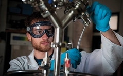 Nick Harris works in a College of the Atlantic lab to transform food waste into butanol.