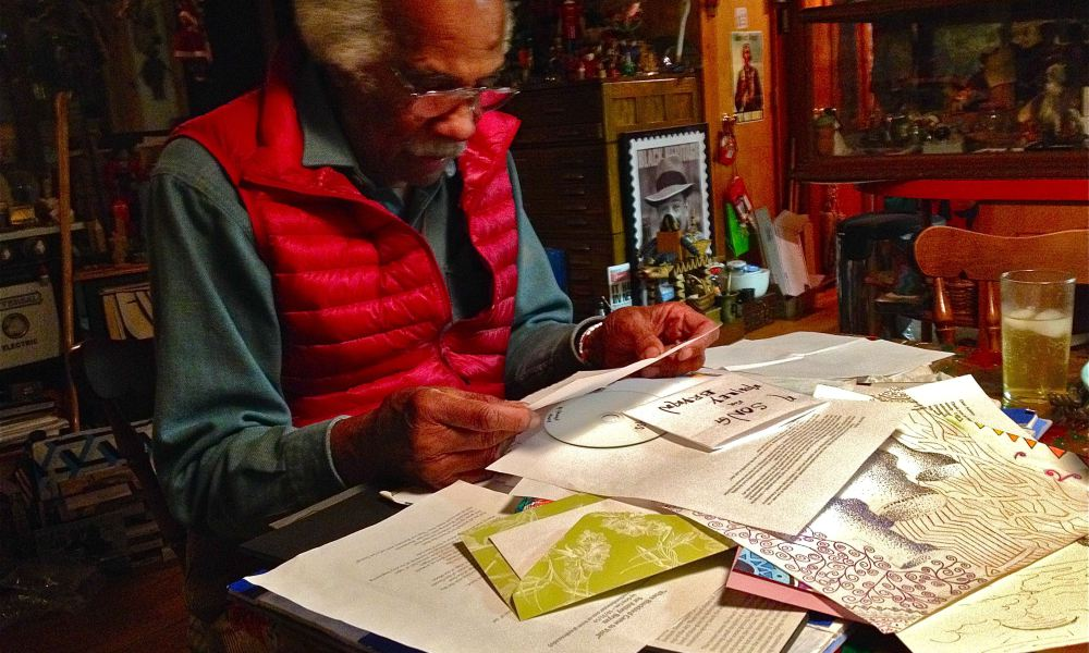 "Islesford artist Ashley Bryan goes through reams of appreciative letters generated by his exhibit, ""A Visit With Ashley ..."