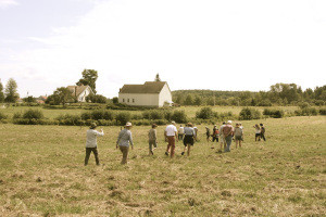 Students make their way across a field at Peggy Rockefeller Farm