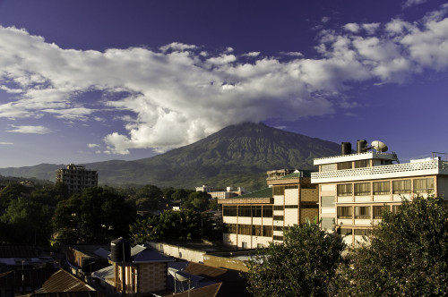 Mt. Meru looms behind the city of Arusha, Tanzania.