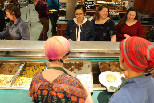 Students line up for breakfast for dinner by Audra McTague '19 during the annual Anthropology of Food TAB Takeover.