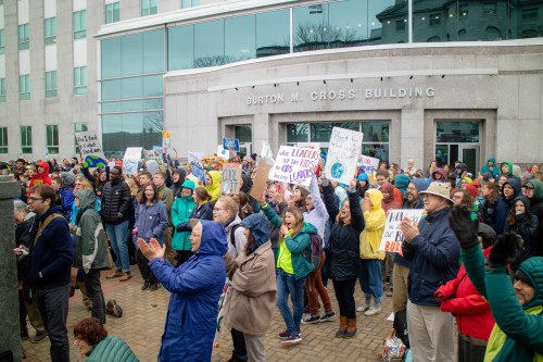 A multi-generational crowd assembles on the grounds of the Maine Statehouse for the Maine Youth D...