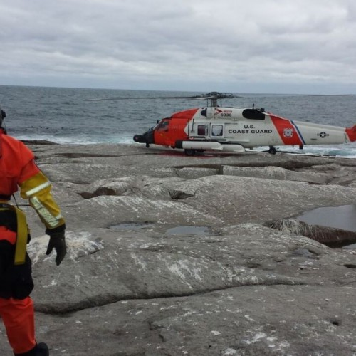 A U.S. Coast Guard helicopter was used to evacuate a College of the Atlantic student and three government researchers from...