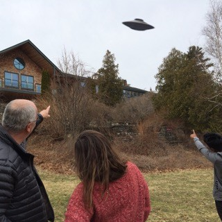 Faculty members and students out behind COA's Thorndike Library catch a glimpse of an unidentified flying object April 1, ...
