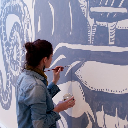 Ella Samuel '16 painting her mural in the Blum Gallery.