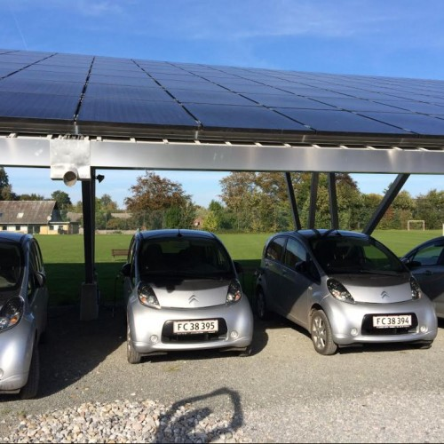 Solar-powered, community-owned solar charging stations on Samsø Island, Denmark, are one example...