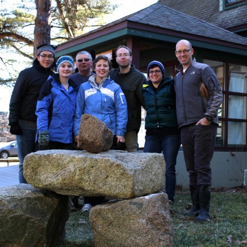 President Darron Collins '92, right, with the crew that helped place the slabs for COA's new Bates cairn.