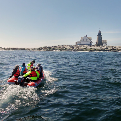 Students use a rigid hull inflatable to travel from College of the Atlantic's MV Osprey to the COA Edward McC. Blair...
