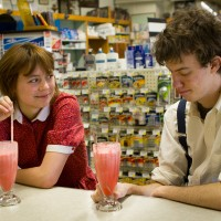 Zabet NeuCollins and Ben Moniz,  as Emily and George, share sodas at the West End Drug Co. in Bar Harbor  during a rehears...