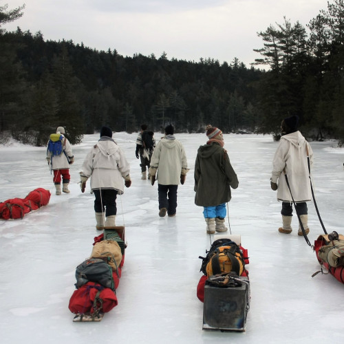Trekking across frozen lakes in the middle of the Maine Wilderness is all part of a day's work for Traditional Skills Club...