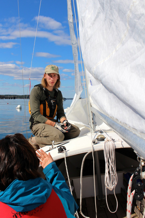 "College of the Atlantic sailing program participant Sterling Ford '20 bounces ideas off of Priyamvada Chaudhary '20 while preparing to sail on Frenchman Bay. The Bay is just one of <a href=""/about/bar-harbor-maine/acadia-national-park/"" target=""_blank"" rel=""noopener noreferrer"">many</a> natural and beautiful resources surrounding COA."