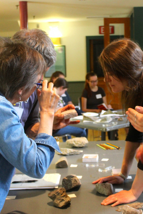 COA education studies students and Maine teachers closely observe and analyze rocks and other artifacts at the SUCCESS Institute, which leads them to reflective discussions and new perspectives they can bring to their future students.