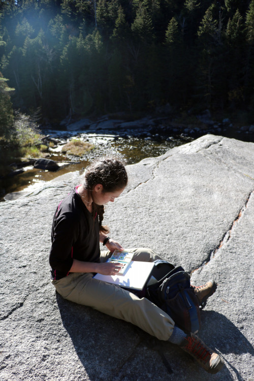 Jessica Arseneau '18 opens her watercolor set to paint the beautiful surroundings at Nesowadnehun...