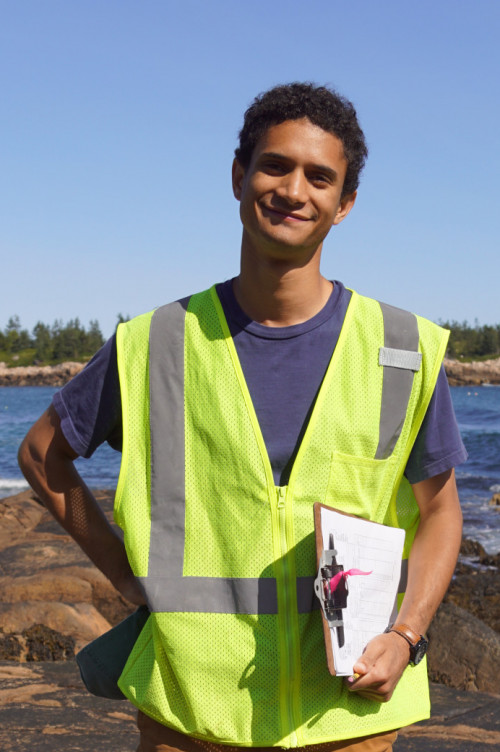 COA student Noah Rosenberg '18 takes a break while working in the field on Acadia National Park...