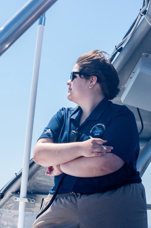 Grace Leary '22 watches for whale tails and blows while working as a research assistant for B...