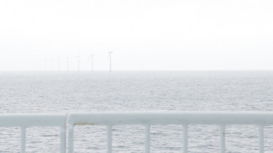 Offshore wind turbines emerging out of the fog. Taken on the ferry from Kalundborg to Samsø.