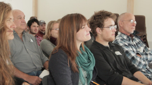 COA students and course participants listen to Samsør Energy Academy Director Søren Hermansen. ...