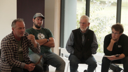 Taking part in a group discussion and orientation at the Samso Energy Academy, from left, are Samso Energy Academy Director Soren Hermansen; Zak Kendall, of New Sharon, Maine; Sam Saltonstall, of Peaks Island, Maine; and Wade Lyman, of Mt. Desert, Maine.