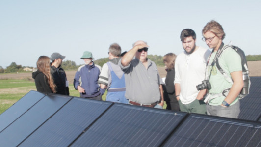 Energy consultant Bernd Garbers gives students and CIERA islanders a tour of his solar panels, Sept. 27.