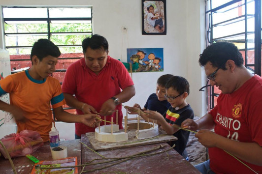 Centro Cultural RealizeArte students in Mayan culture workshop playing traditional games and building a Mayan house with teachers Gener Chan and William Gonzalez.