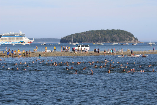 Swimmers begin to make their way across the bay.