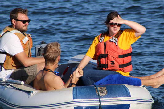 Boat crews are always at the ready to grab tired or cold swimmers.