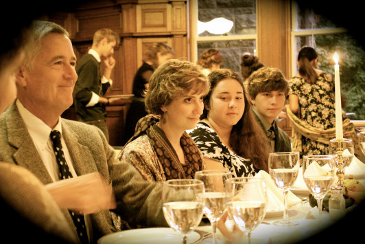 The original dining room of The Turrets, now a classroom, creates an elegant atmosphere for the Acadia founders' dinner. Pictured are, from left, Mount Desert Island Historical Society Director Tim Garrity, Emma LaVercombe '18, Elizabeth Signore '19, and Will O'Brien '19.
