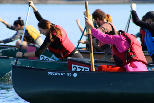 Participants in the 2015 canoe race are eager to be the first to reach Bar Island.