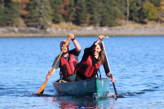 The 2015 canoe race is a hard-fought competition, but teams manage to have plenty of fun.